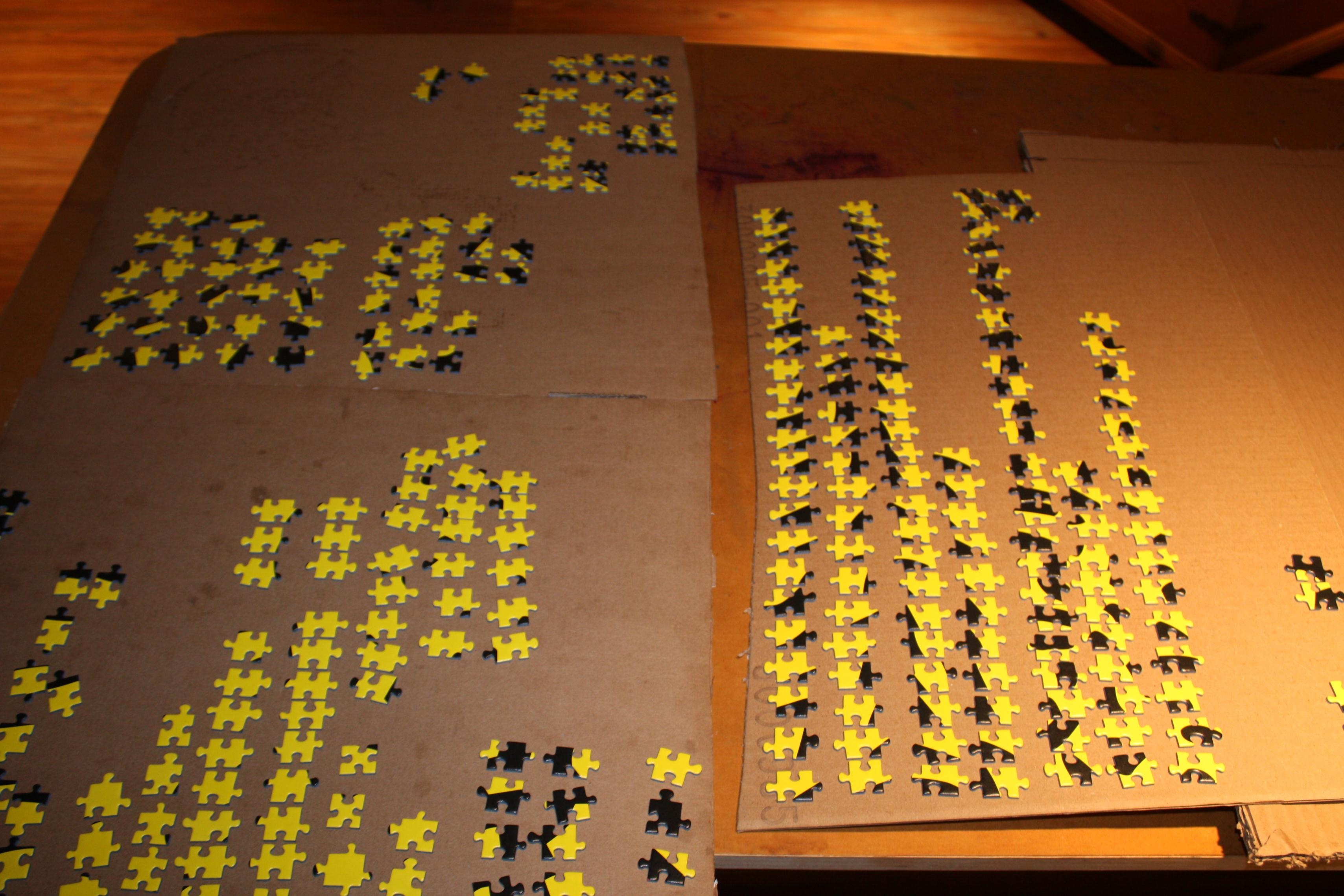 Yellow pieces sorted in section A of Ravensburger 32,000 piece puzzle